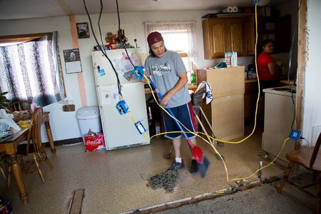 Shaw works to upgrade their transplanted house by replacing the original electric wiring