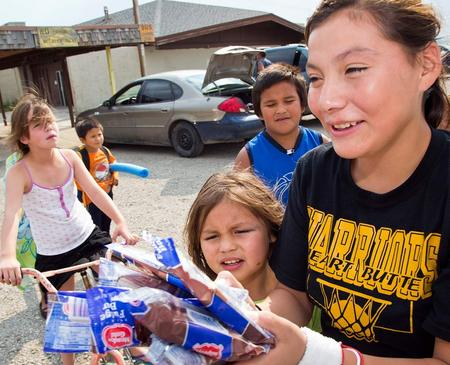 A girl purchases treats for her siblings outside of the Blackfeet Community Pool in Browning, Montana