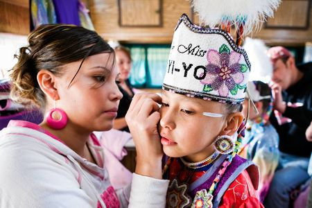 Mother Tiffany Polk prepares her daughter, Danaya Vandeburg for the Tiny Tot Competition