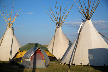 Many families stay together in traditional teepees during the four-day festivities.