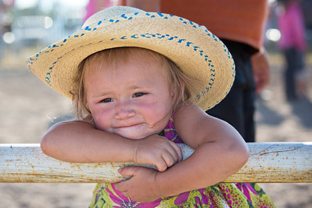 Dally Michael (2) watches her siblings compete in the summer Youth Rodeo.